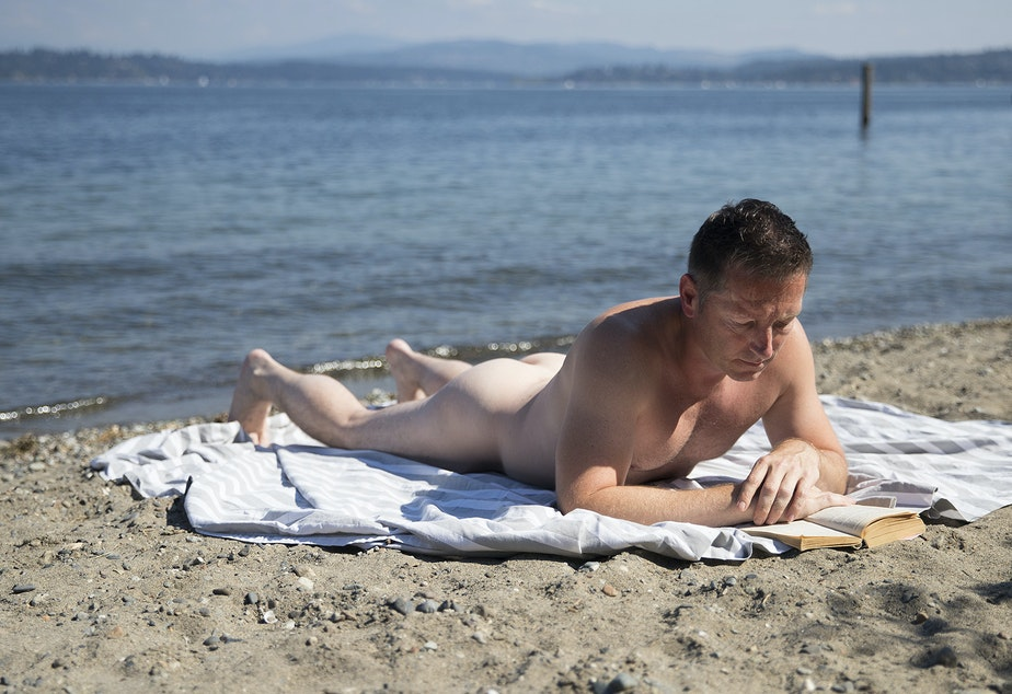 caption: Patrick Beringer at Howell Beach in Seattle. Nudity became legal in Seattle in 1990. Indecent exposure remains illegal, however.