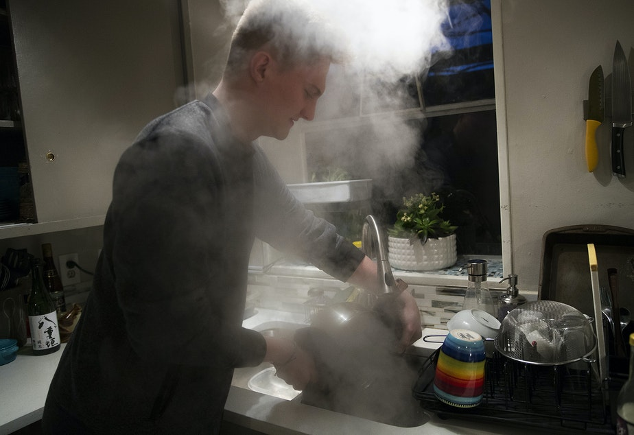 caption: Biggest carbon loser contestant Will Wilson cooks ramen at his apartment on Monday, February 10, 2020, in Seattle.