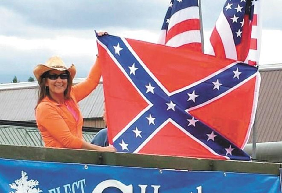 caption: Idaho Rep. Heather Scott sparked controversy in 2015 when she posed with a Confederate flag on her campaign float at Priest River, Idaho's Timber Days parade.