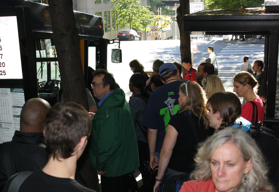 caption: Bus riders are used to competing for the few remaining spaces at the last stop before many West Seattle-bound buses enter the Viaduct. If Proposition 1 passes this November, King County would increase service at congested stops.