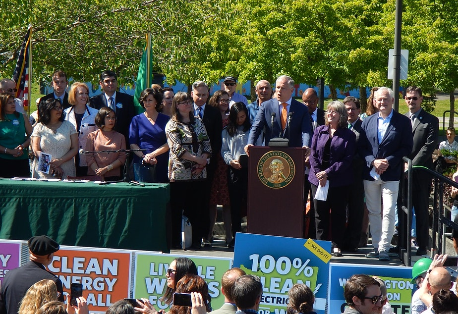 Washington Gov. Jay Inslee at a signing ceremony for five climate bills on Tuesday in Seattle.
