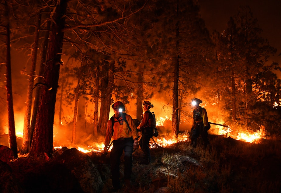 caption: Lake Tahoe, CA. September 2, 2021: Firefighters battle the Caldor fire along highway 89 west of Lake Tahoe Thursday.