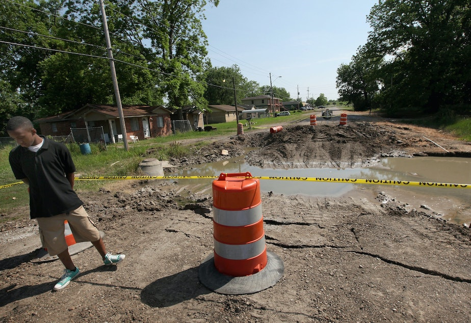 caption: Water that came under a levee in Greenville, Miss., in 2011 caused this street to collapse. The city has had major floods twice since then, including record-breaking high water this year. Greenville's mayor says many residents live in low-lying areas served by outdated infrastructure.